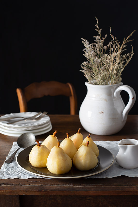Poached Pears on a Rustic Farmhouse Table Stock Food Photo