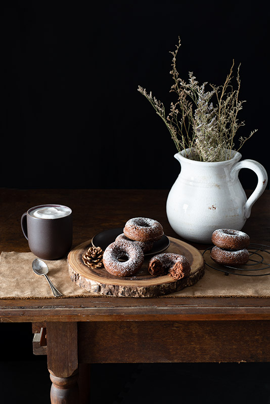 Chocolate Donuts on a Farmhouse Table Stock Food Photo