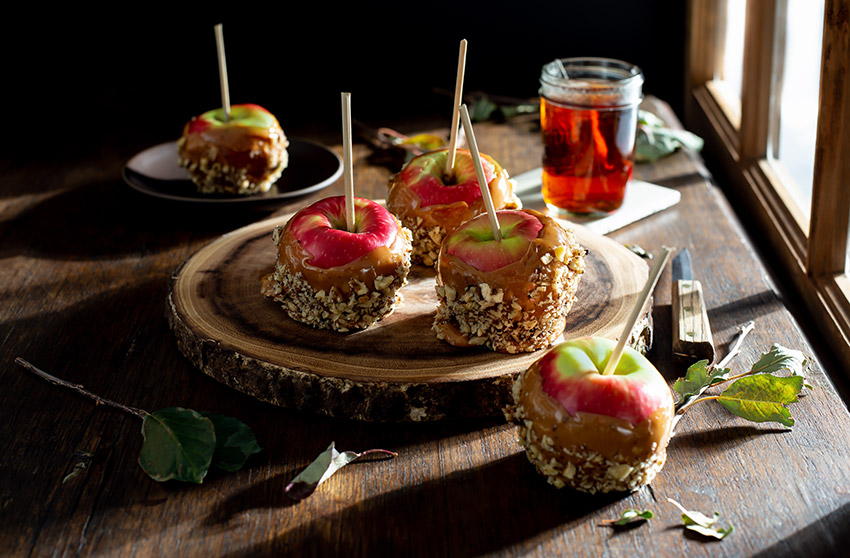 Caramel Apples on a Rustic Farmhouse Table Stock Food Photo
