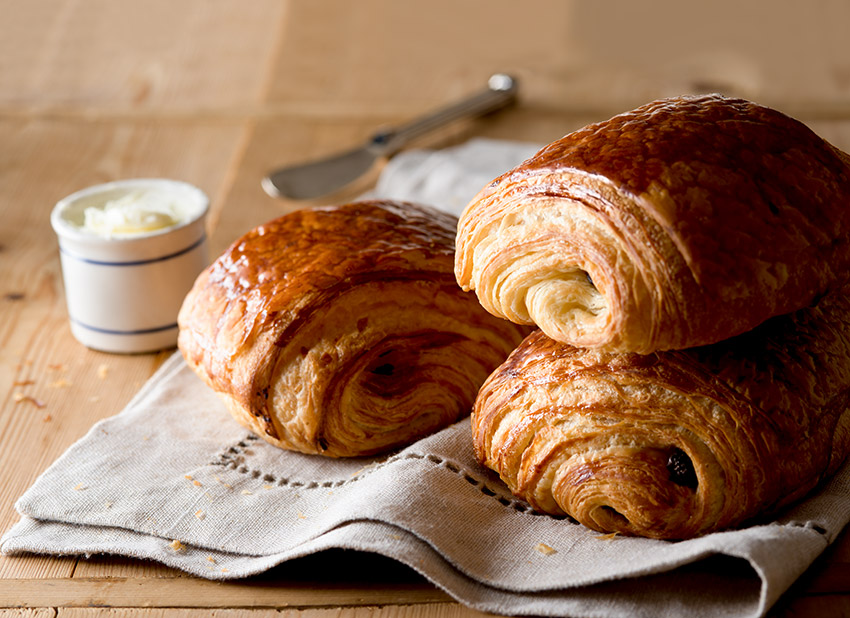 Freshly Baked Chocolate Croissants with Butter Stock Food Photo