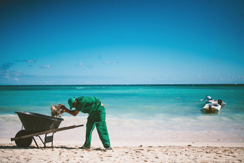 Resort workers clean the beach for garbage BavaroBeach, Punta Cana, Dominican Republic