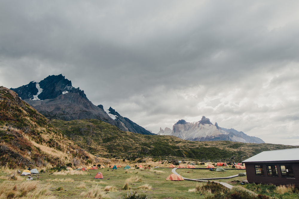 The tent city at the Paine grande campsite, in Torres Del Paine National Park in Chile - a rainbow of shelters and absolutely beautiful, but like the receding glacier if the rampant number of tourists (200,000 up to 300,000 in the 2015/2016 season) continue to come in this number unregulated, the pressure on the unique ecosystem will destroy it.