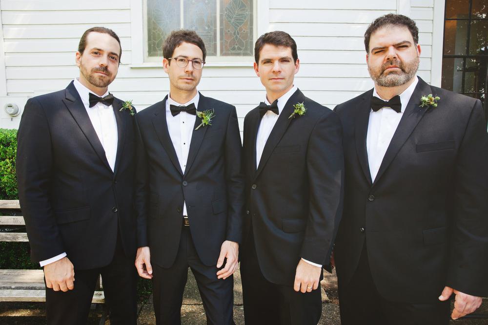 serious-groomsmen-boutonnieres.jpg