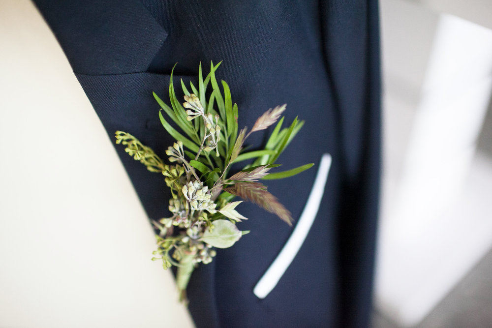 close up on the groom's boutonniere