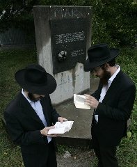 This is the Sept. 2007 file photo of Chabad Rabbi Motti Seligson, and Chabad Rabbi Saadya Notik, left, from New York visit the World War II Nazi concentration camp Sajmiste in Belgrade, Serbia