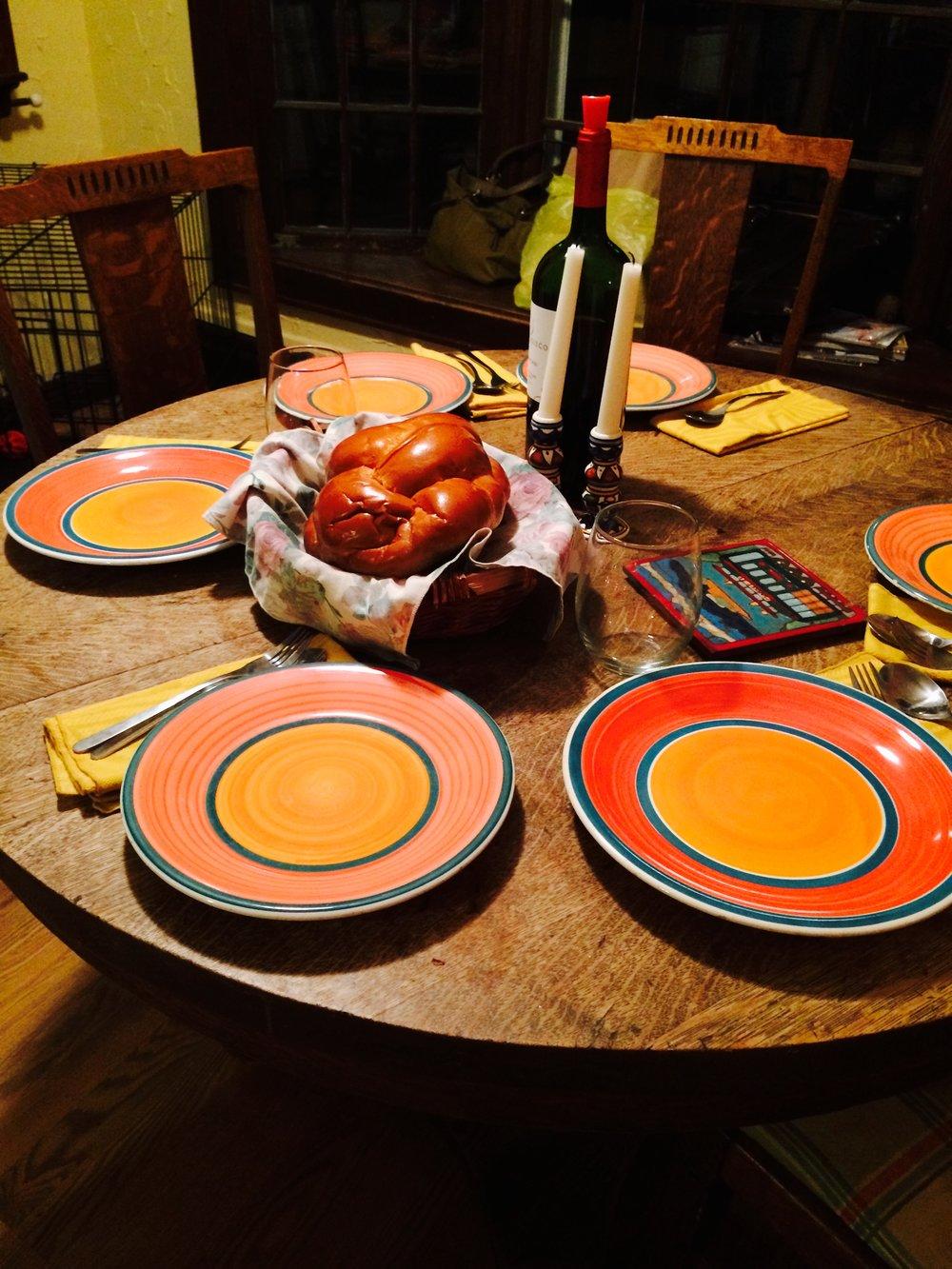 My childhood kitchen table, set up for  Shabbat Dinner .