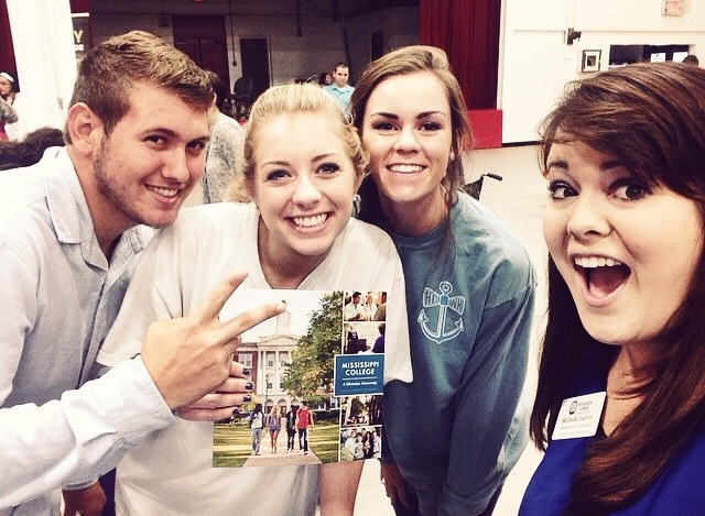 That's a picture of her with some cool kids from a College Fair at Harrison Central High School!