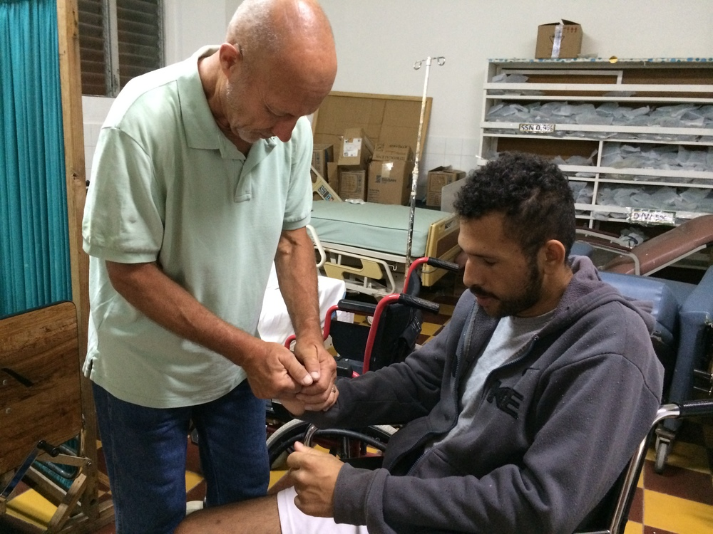 Praying with a man in the hospital in Santa Rosa.  We distributed 300 servings of soup and then offered prayers.