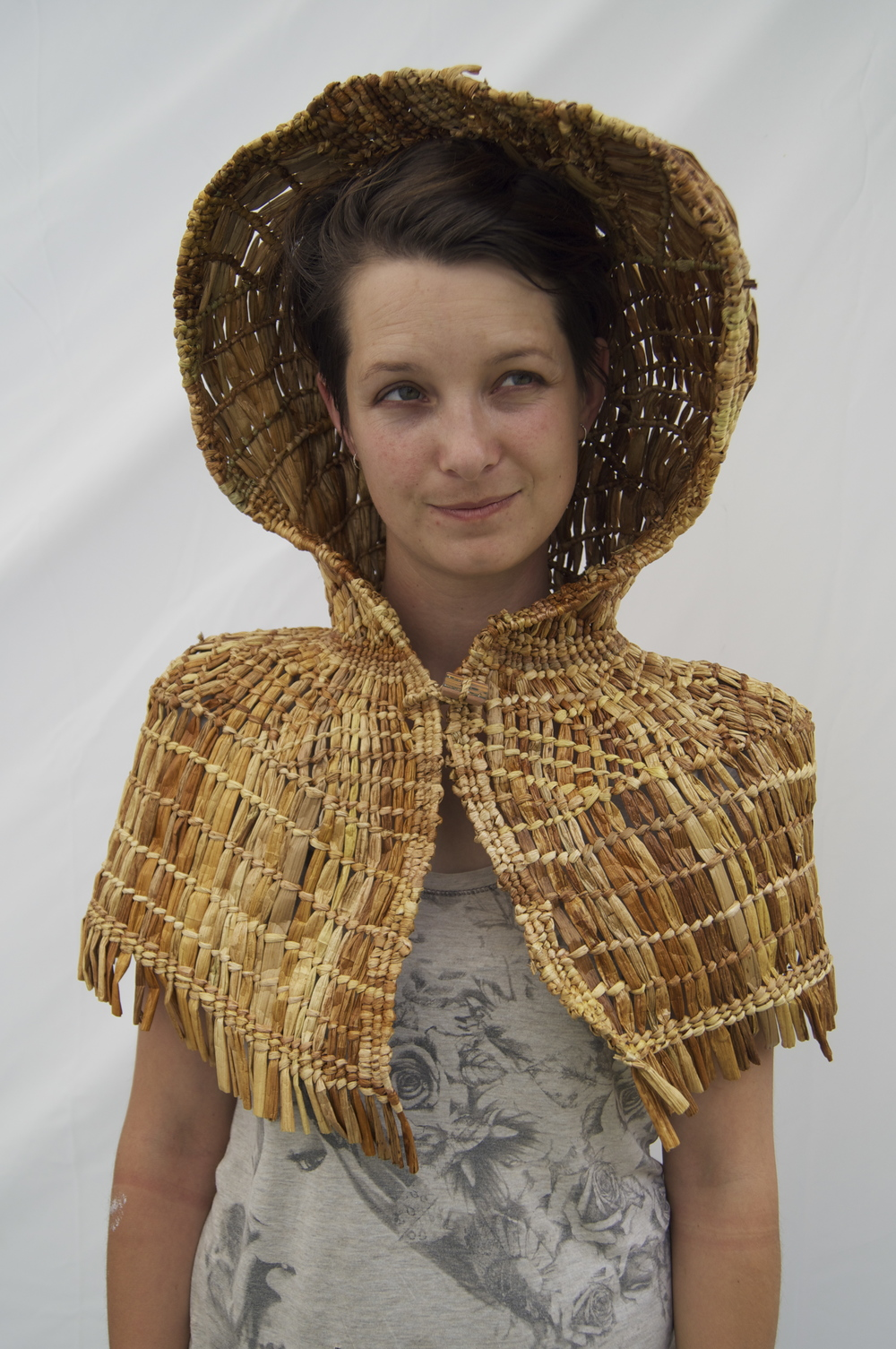 'In the Hood' Woven out of Kuta a lake reed which is a traditional weaving material used to make rain capes. This piece is about retaining cultural identity while operating in an urban reality. Weaving by Bethany Edmunds, January 2014