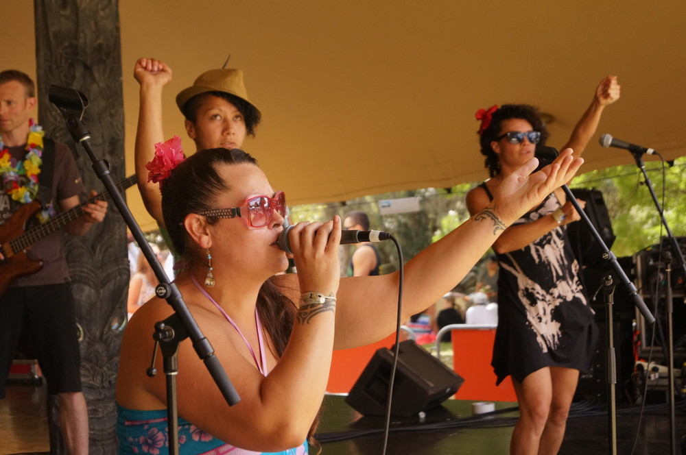 Miss bMe (aka Bethany Matai Edmunds) performing with her band Kinaki on the Aotearoa stage at Pasifika Festival, March 2014