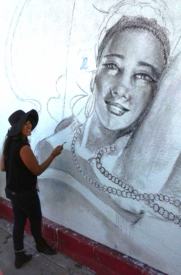 Nani Chacon sketches out a new mural in Bareles, NM.