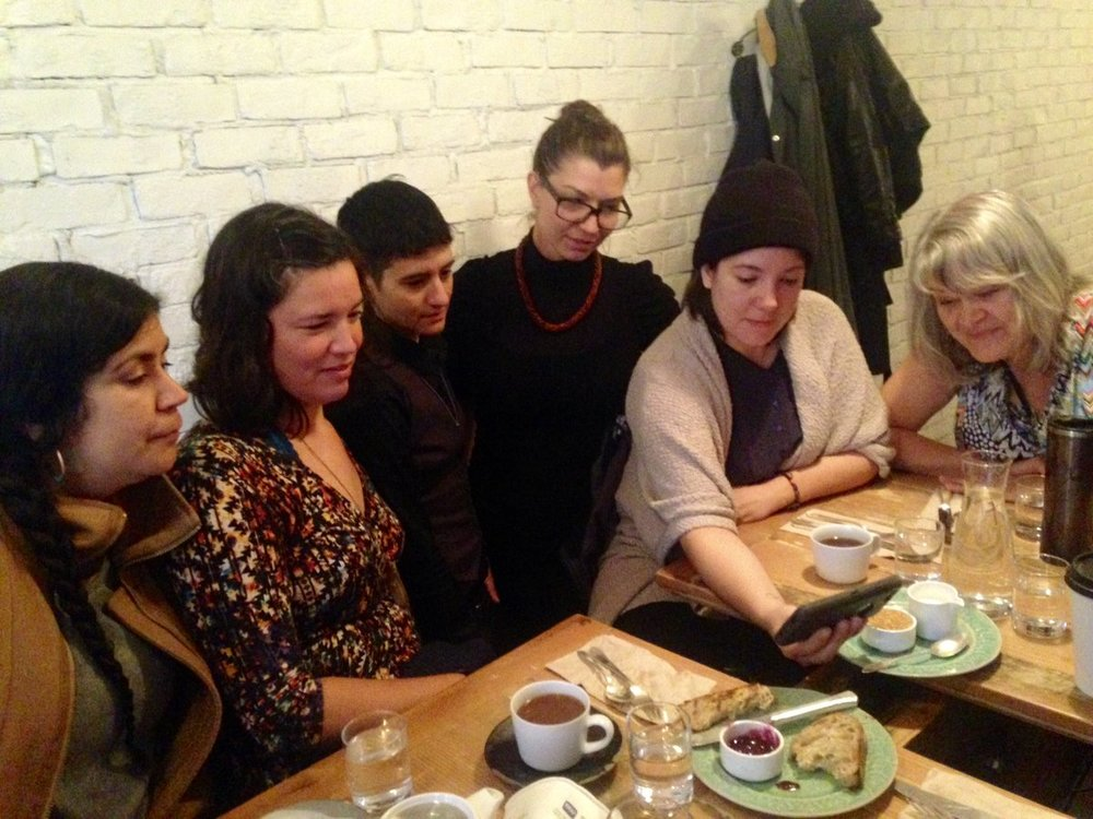 Tania Willard, Maria Hupfield, IV Castellanos, Ginger Dunnill, Tarah Hogue, Cherylle L'Hirondelle viewing Tanya Tagaq's Retribution video. Vancouver, BC.