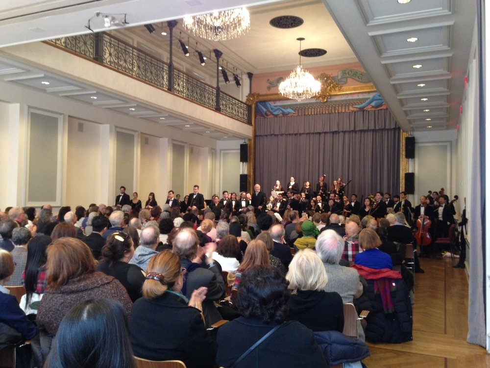 Maestro Maurice Peress and the Orchestra of the Aaron Copland School of Music perform before a full house in the historic ballroom of the Bohemian National Hall.  Photo Credit: DAHA