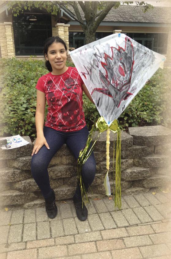 Jasmine- with kite she made_edited-1.jpg