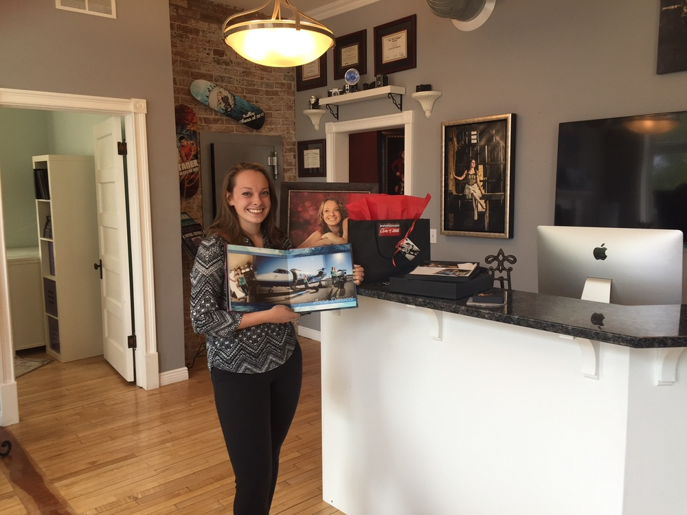 Anna with her album and custom-framed wall art!