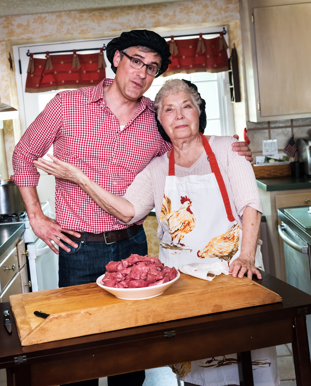 Host Mo Rocca helps prepare the kitchen and ingredients for today's stew and cherries, as seen on Cooking Channel's My Grandmother's Ravioli, Season 4.