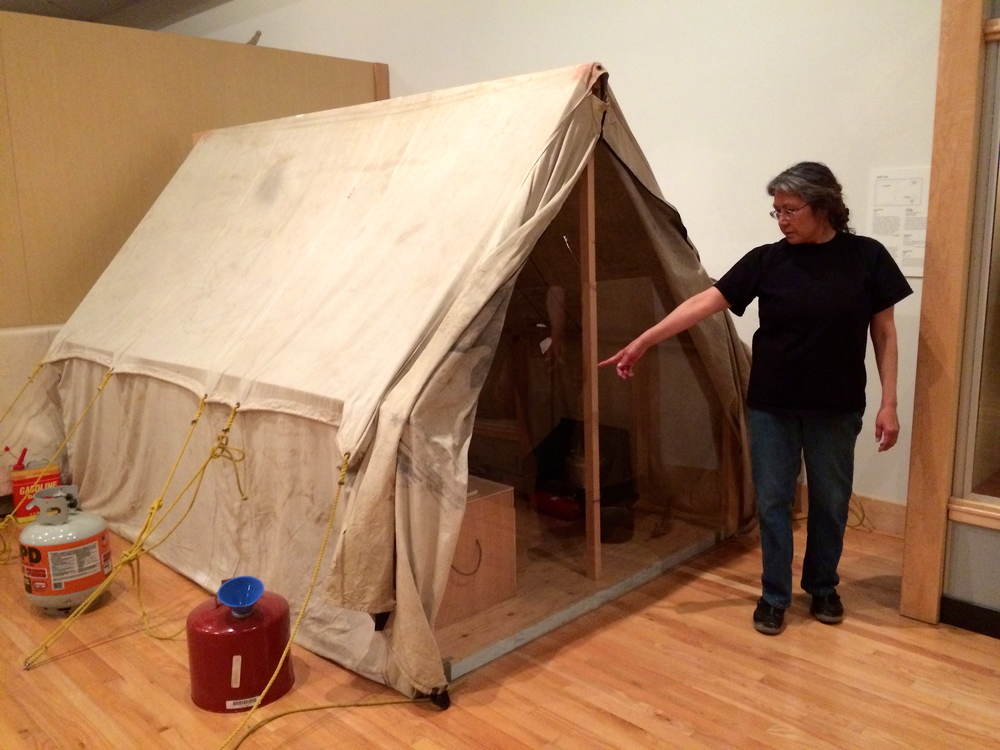 Our tour guide explains a typical whaling camp tent structure.