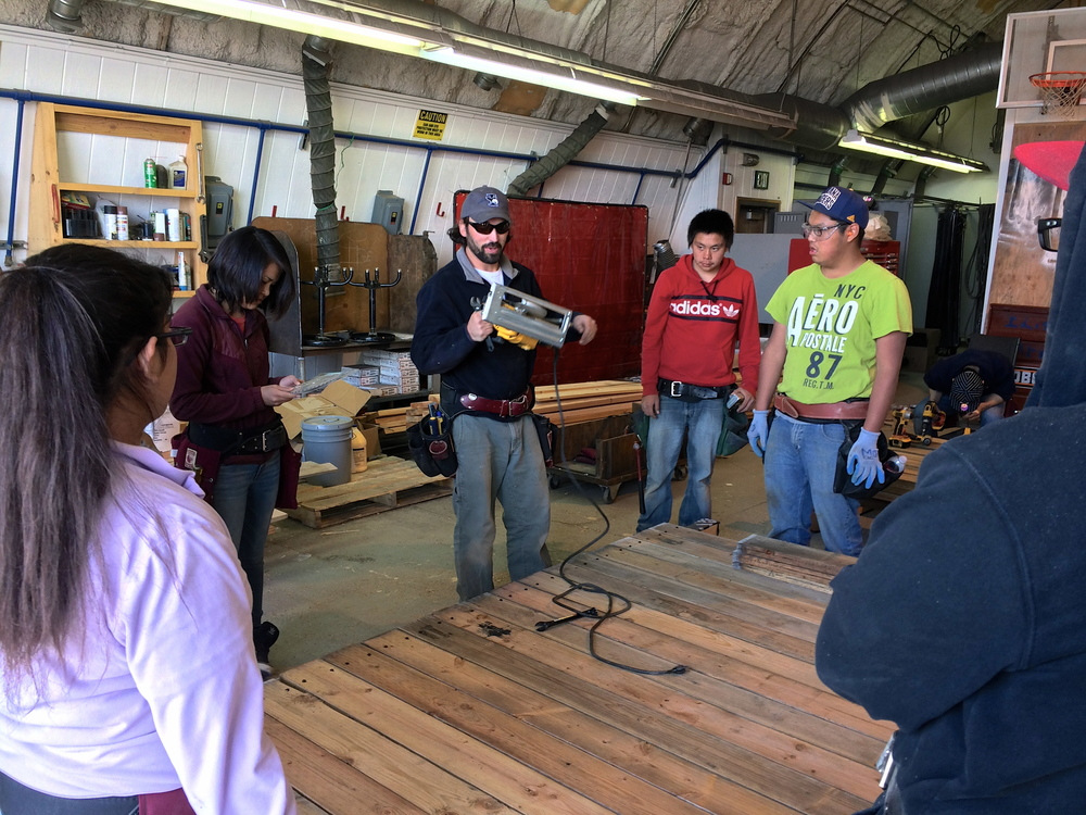 Nick gives a lesson on using a skilsaw to trim up the deck boards on the sled.