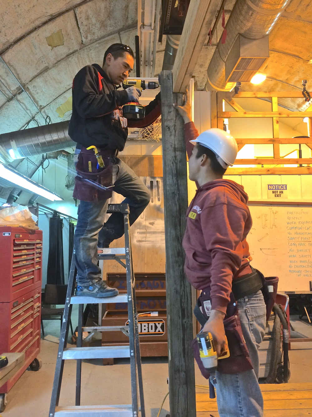 Joe and Geoffrey work together to install a beam.