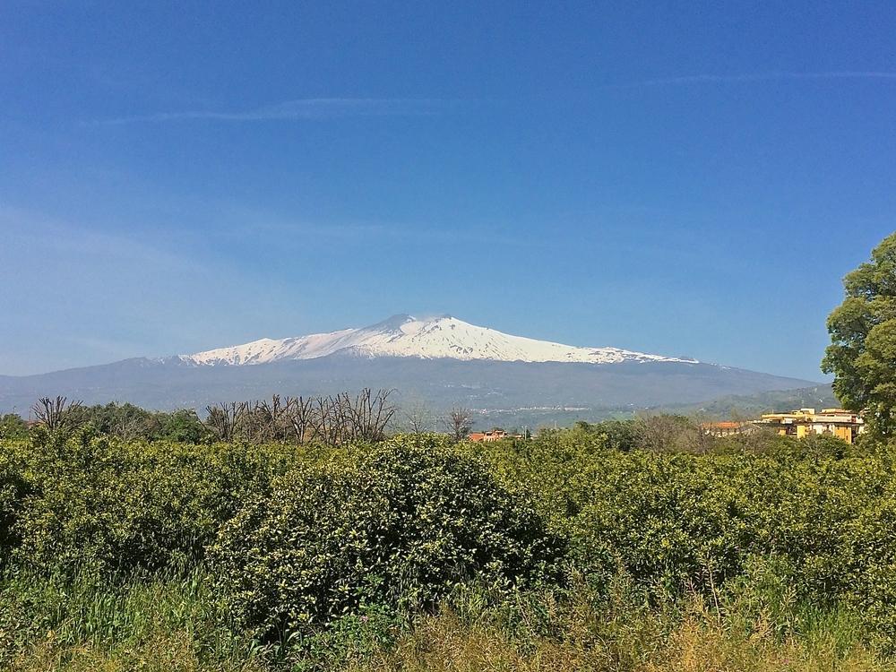 Etna towering above Giardini-Naxos.