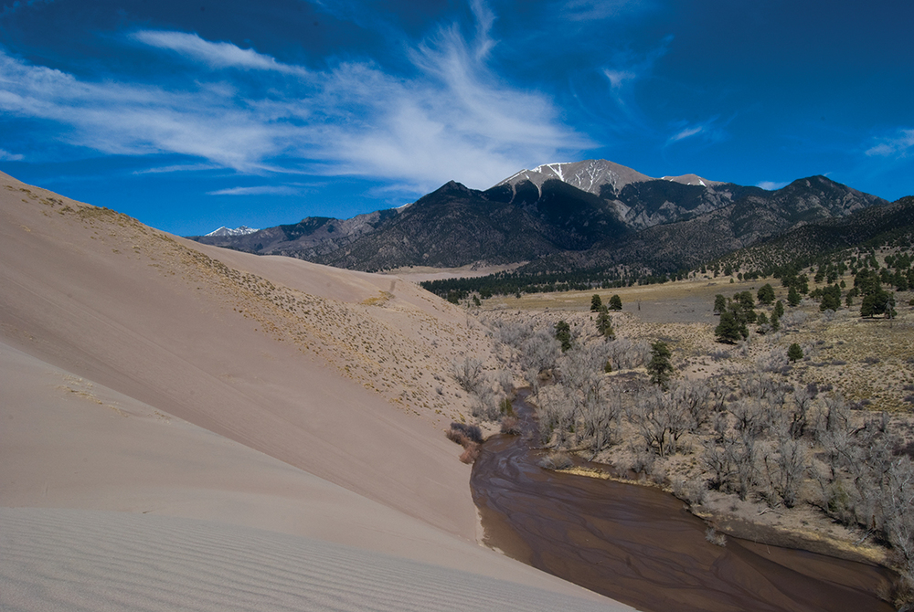 Medano Creek flows seasonally out of the Sangre De Cristo Mountains before soaking back into the dune field.