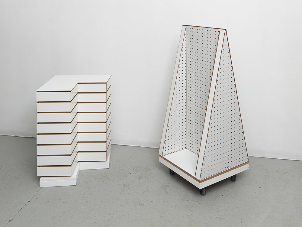 Rachel Higgins   , Rotating Display,    2015  , MDF slat, hardware, Lazy Susan, MDF  , 26 3/4 in. x 17 1/4 in. x 17 1/4 in.   ; Utility Tower   , 2015  , Peg board, dolly, hardware, wood  , 44 in. x 17 in. x 17 1/8 in.