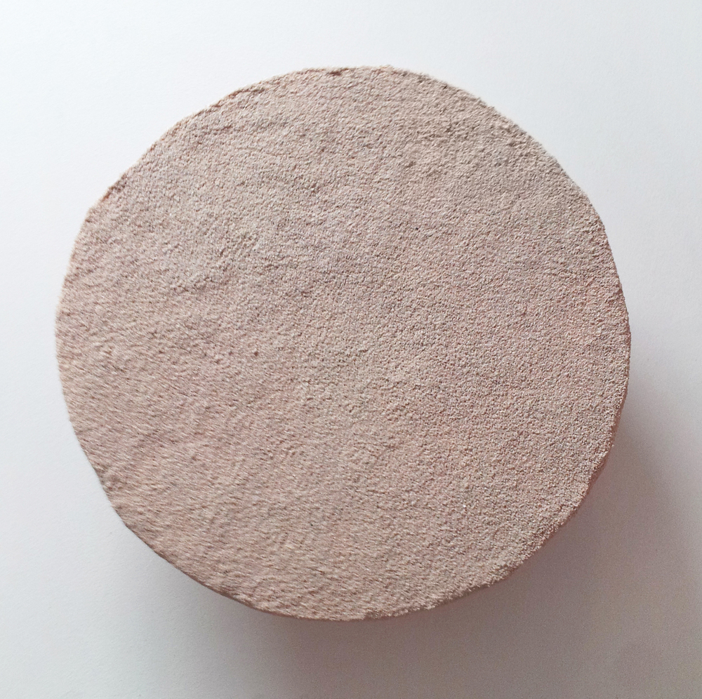 Rachel Higgins , Clock, 2015, Styrofoam, cerastone, wood, hardware, 1 RPM motor, AA batteries, 13 in. diameter