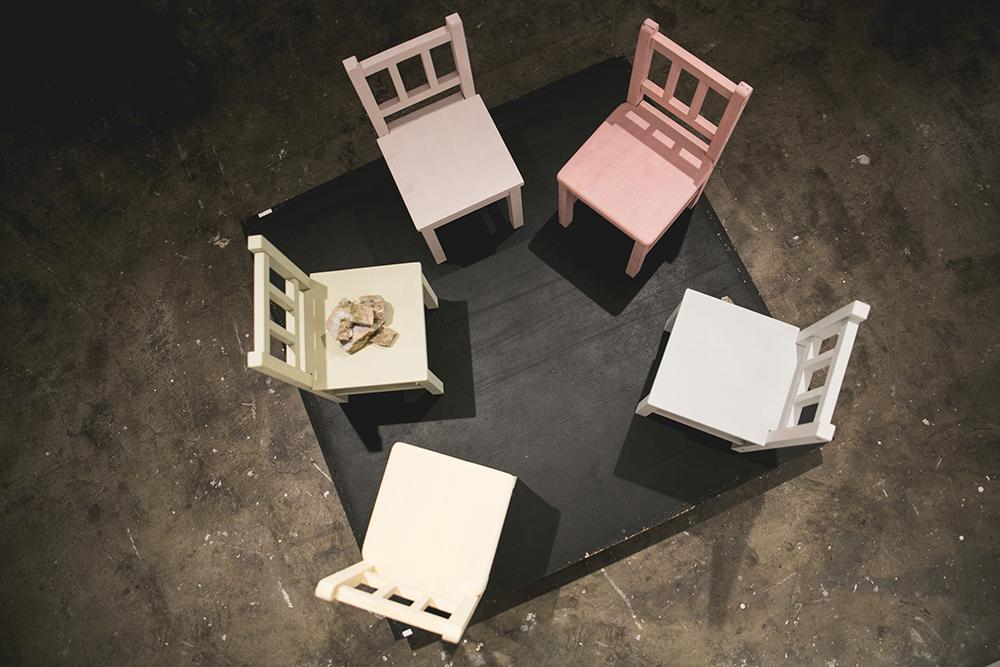 2018  Playtime , detail; children's chairs, broken concrete/rocks, milk paint, theater platform, 4'4'