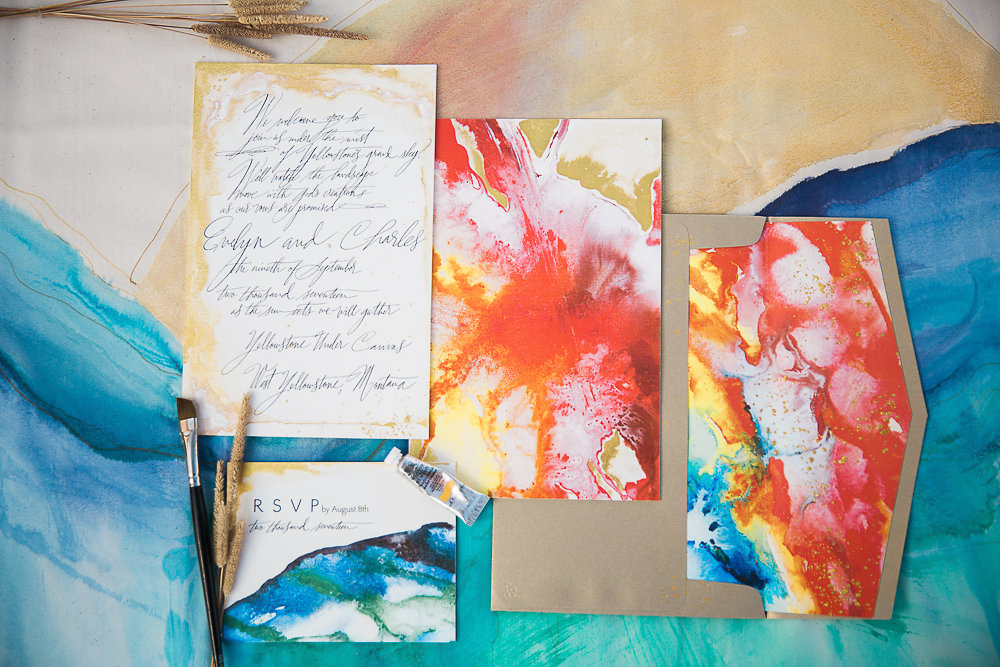 Kristy's vibrant invitation suite inspired by the jewel toned hot springs of Yellowstone National Park