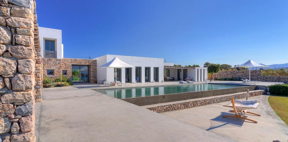 Esthetische toepassing breuksteen in architectuur - vakantie villa in Santorini - Griekenland