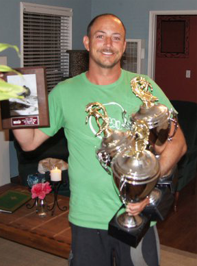 Chris with his 3 (2011) NSSA surfing titles. Go Uncle Keet!