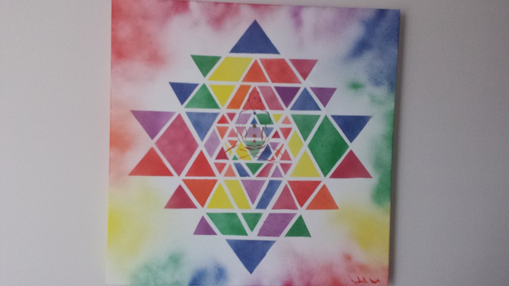 Sri Yantra by Jon-Michael Bir featured at the reception desk at Total Zen