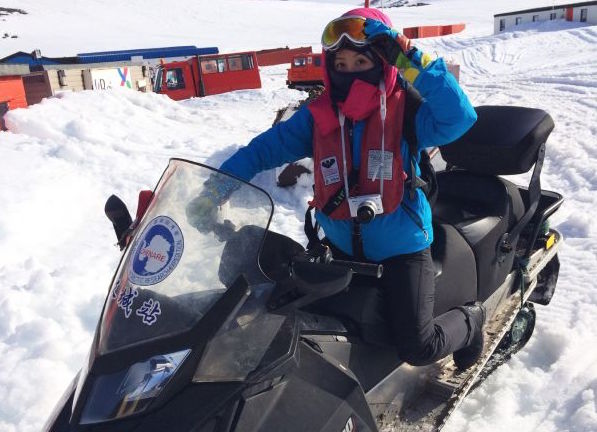 Isabel ski-dooing in Antartica, one of her best travel highlights.