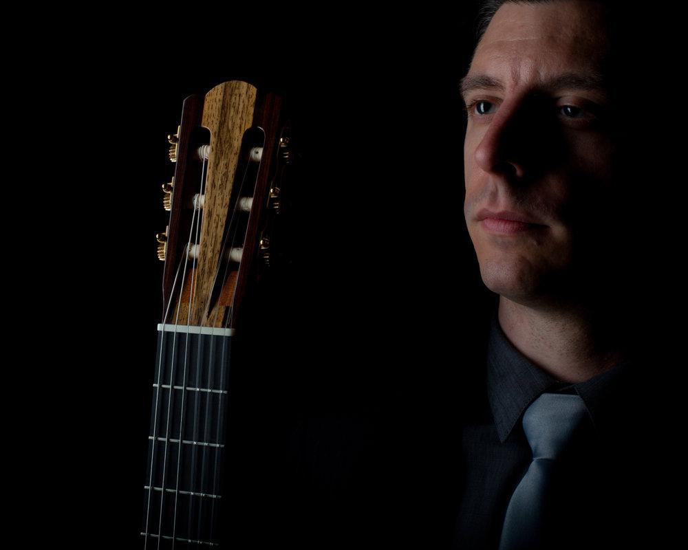 Kevin-J-Cope-holding-Douglass-Scott-Guitar-credit-Brian-Mengini.jpg