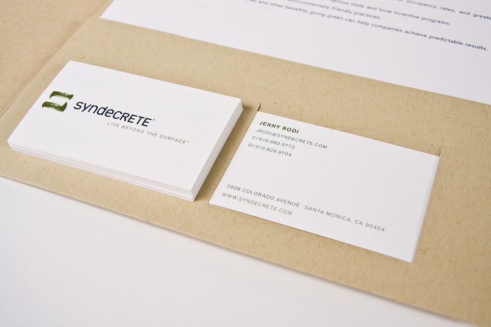 The brand identity and corresponding stationery set is minimal yet balanced.