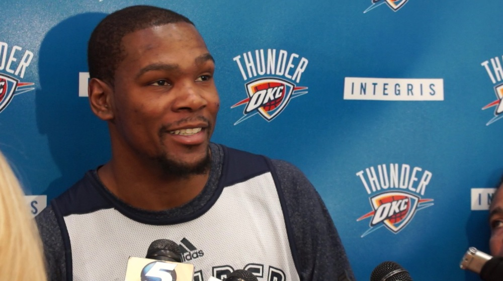 Kevin Durant talks to reporters - Photo by Jeremy Griffin