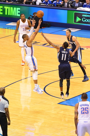 Russell Westbrook shoots over the Grizzlies Mike Conley Saturday night. Photo by Torrey Purvey for InsideThunder.com