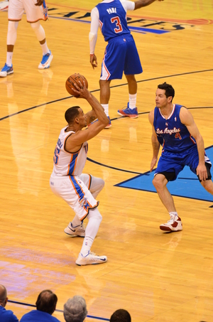 Thabo Sefolosha works against Clippers guard J.J. Redick. Photo by Torrey Purvey for InsideThunder.com