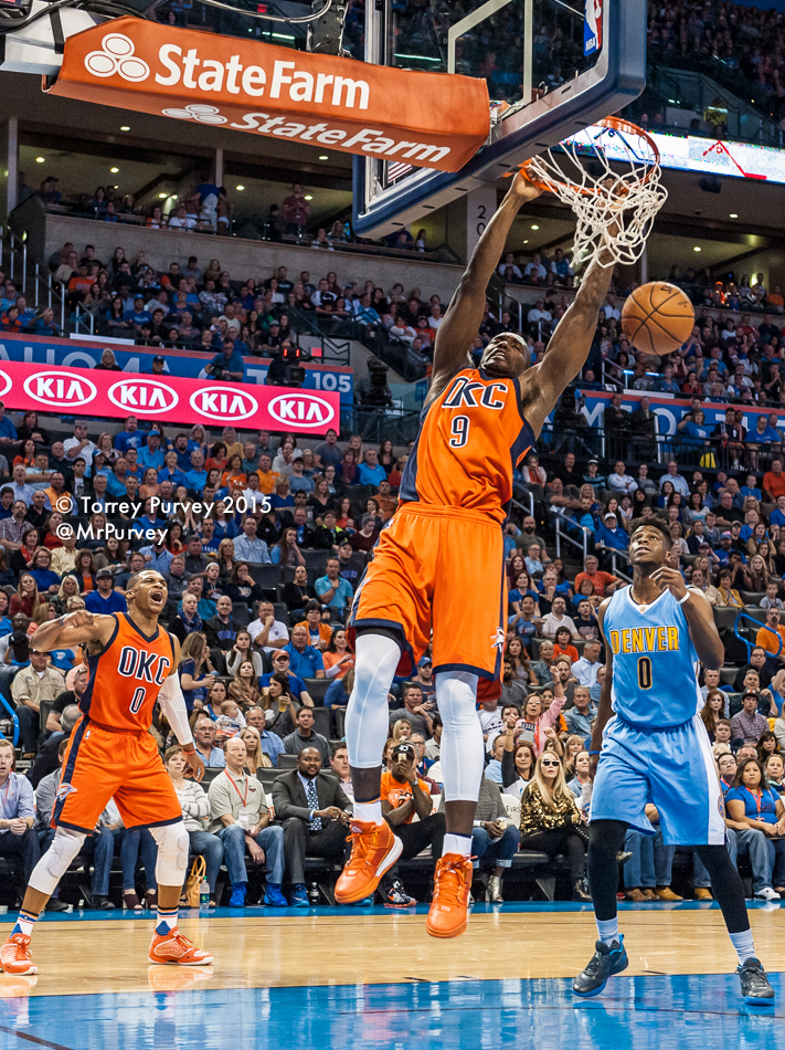Serge Ibaka (#9) slams home a basket at Chesapeake Energy Arena after a dish from Russell Westbrook (#0). Photo by Torrey Purvey for InsideThunder.com