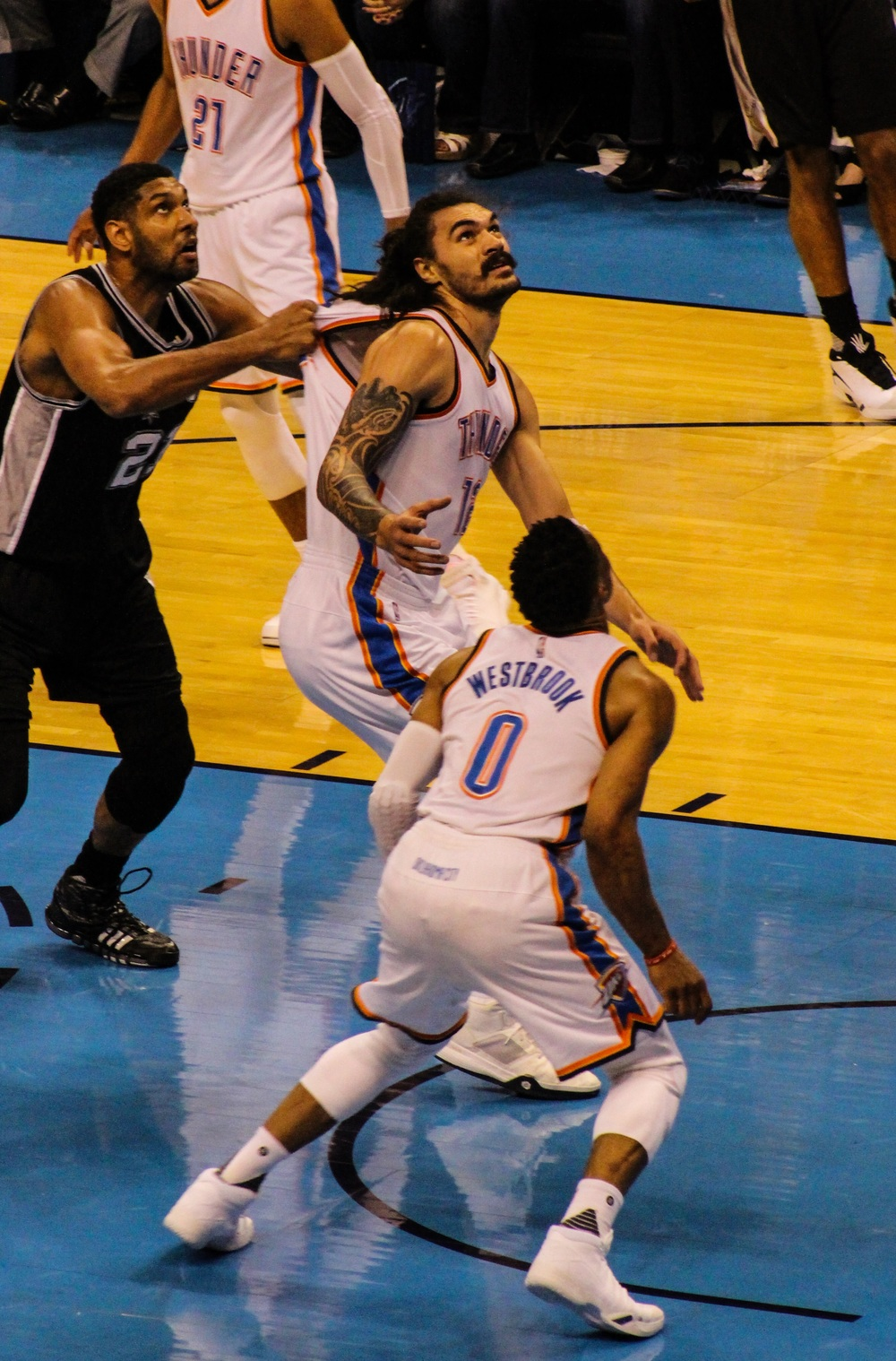 Thunder center Steven Adams has his jersey yanked by Spurs center Tim Duncan during Game 6 of the Western Conference Semi-Finals. (Photo By Sam Murch/InsideThunder.com)