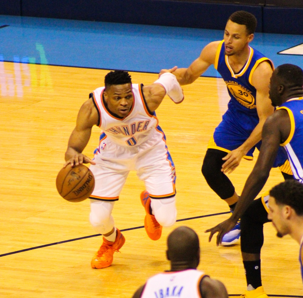 Russell Westbrook drives around Steph Curry during OKC's 118-94 win over Golden State in Game 4 of the Western Conference Finals. (Photo By: Sam Murch/InsideThunder.com)