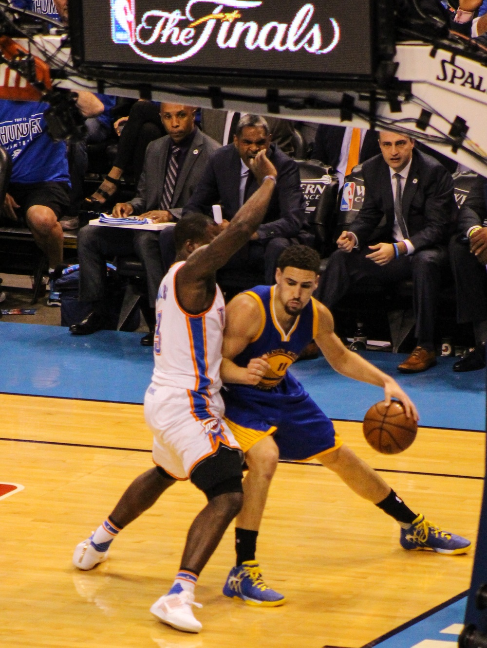 Warriors shooting guard Klay Thompson drives around Thunder guard Dion Waiters in Saturday's 108-101 Golden State win in Game 6 of the Western Conference Finals. (Photo By Sam Murch/InsideThunder.com)