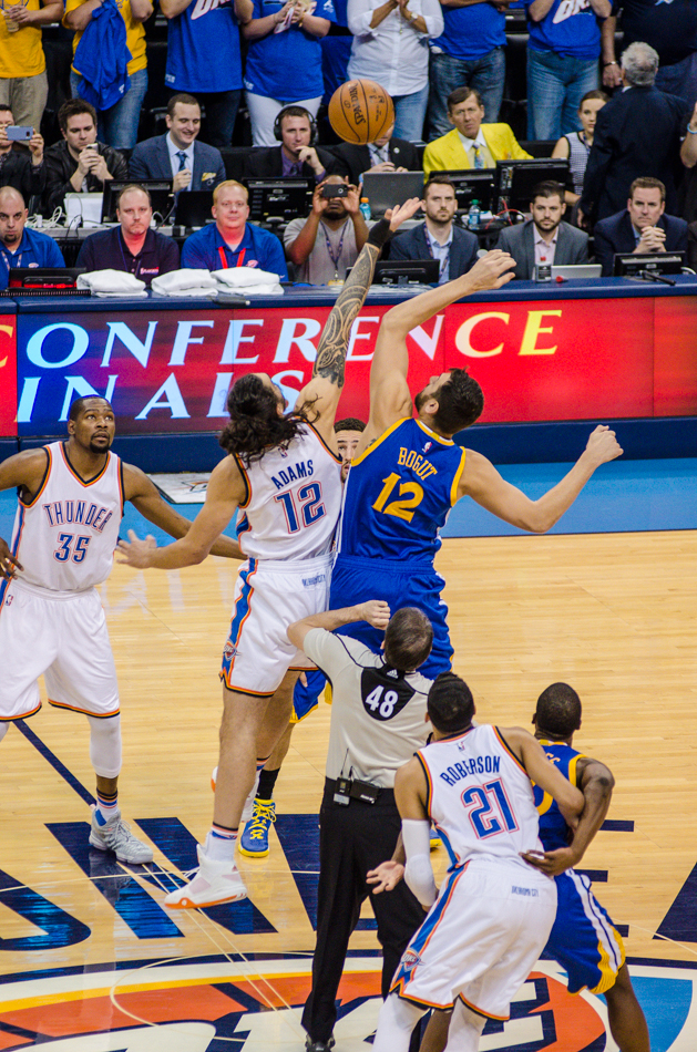 Steven Adams and Andrew Bogut go for the tip in Game 3.  Photo by Torrey Purvey/ InsideThunder.com