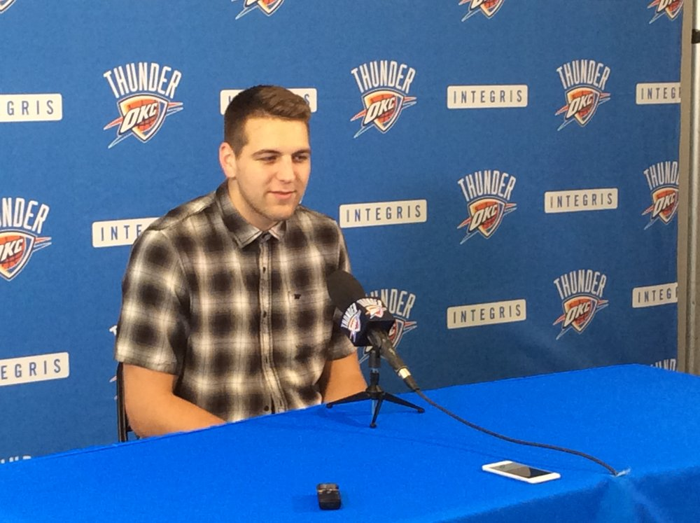 Thunder forward Mitch McGary speaks to reporters during the team's exit interviews at the end of last season. (Photo By Randy Renner for InsideThunder.com)