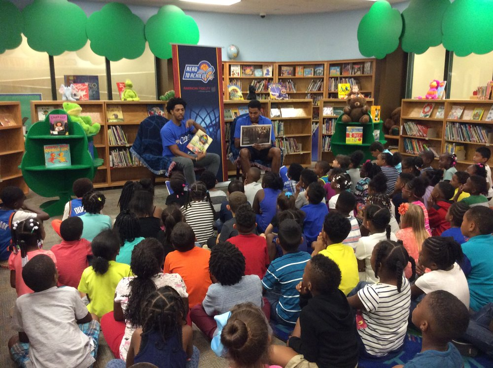 Thunder guard Cameron Payne and forward Josh Huestis read to students at Pleasant Hill Elementary School on Tuesday afternoon. (Photo By Randy Renner for InsideThunder.com)