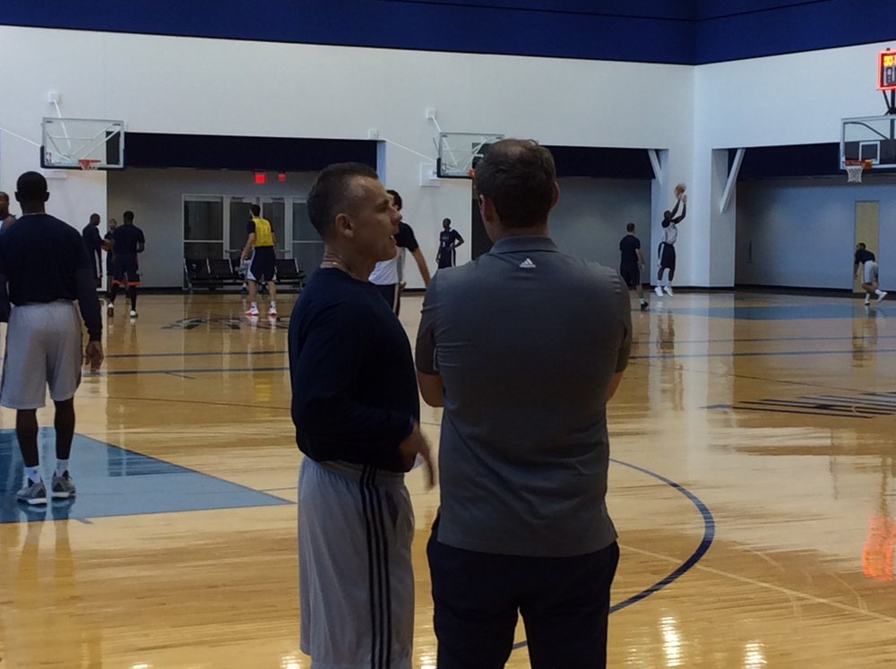 Thunder head coach Billy Donovan talking with communications director Matt Tumbleson at Tuesday's practice. (Photo By: Randy Renner/InsideThunder.com)