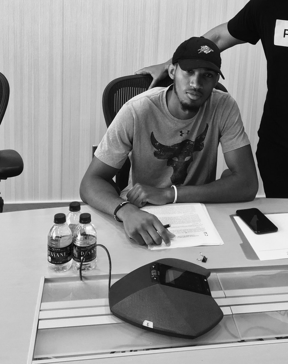 An image from Terrance Ferguson's Twitter feed (@the2kferguson) as he signs his Thunder contract on Saturday.