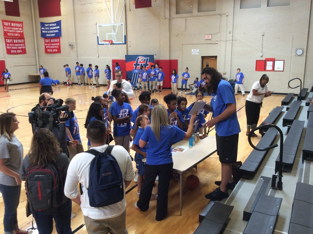 Steven Adams working with Taft Middle School Students during last week's Thunder Fit Clinic. Photo By Randy Renner/InsideThunder.com