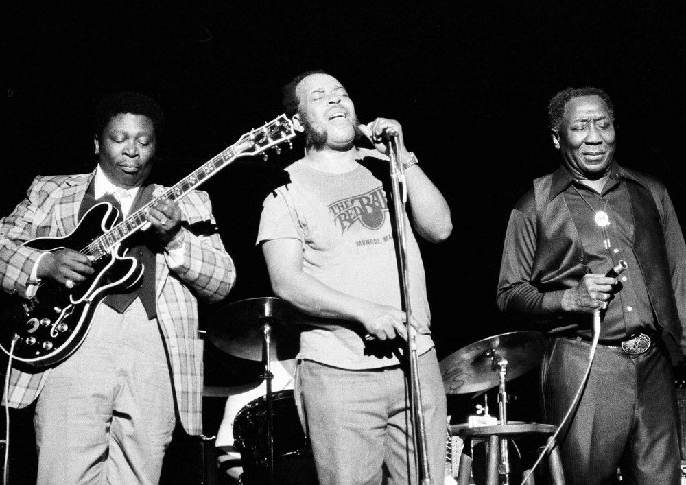 James Cotton, center, with blues musicians B.B. King, left, and Muddy Waters performing in 1979. (Perez/Associated Press)