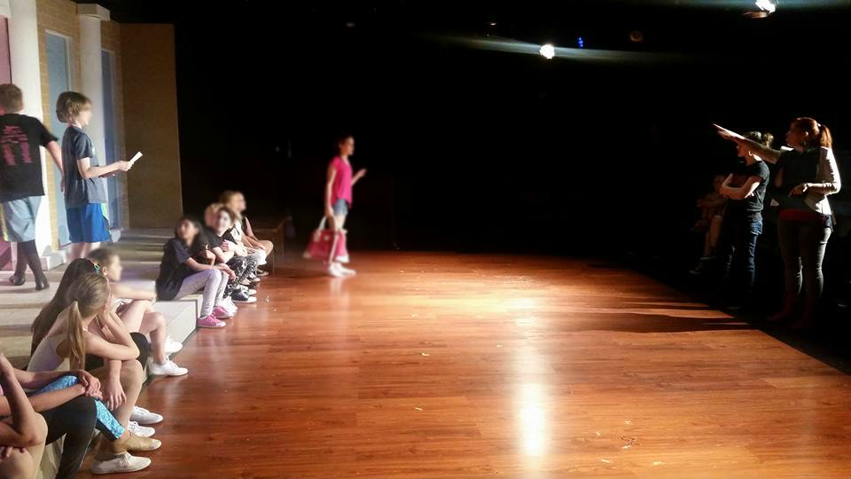 Kathleen directing the cast of  Legally Blonde, Jr.